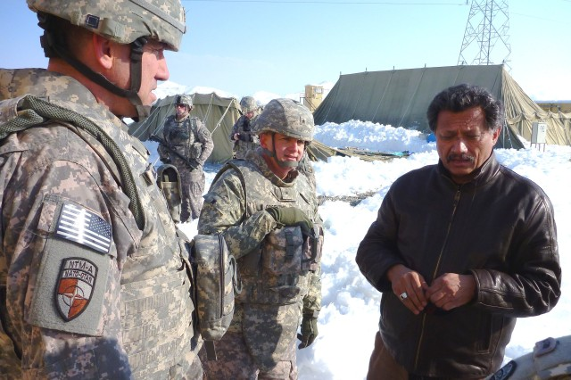 From left, Maj. Gen. James B. Mallory, deputy commanding general, NTM-A/CSTC-A, along with Brig. Gen. Guy T. Cosentino, incoming deputy commander, Regional Support, and Rashid Joyaa, president, Global Engineering & Consulting Services, discuss the status of FOB Hussein Khut Feb. 15.