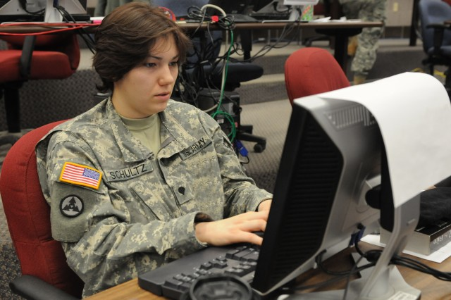 Spc. Rose Schultz, a human resource specialist with the 3d Sustainment Command (Expeditionary), reviews personnel operations during the Joint Operational Access Exercise with Fort Bragg's 82nd Airborne Division from Feb. 8-16. Throughout the exercise, the 3d ESC provided operational level logistics command and control of sustainment and distribution operations. (U.S. Army photo by Sgt. Michael Behlin)