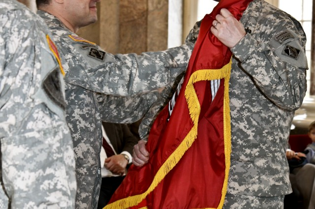 """Col. J. Richard Jordan III accepts the command flag, or colors, from Brig. Gen. Peter """"Duke"""" DeLuca, the USACE North Atlantic Division commanding general, during a change of command ceremony Feb. 10, 2011 at the Schloss Biebrich, Wiesbaden,"""