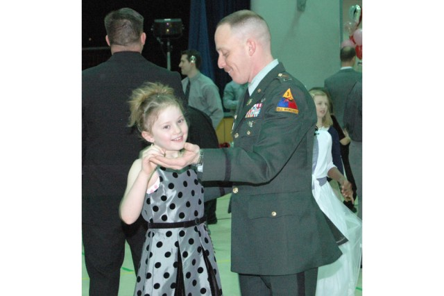 Chief Warrant Officer 3 Eric Schaub, 1st Armored Division, dances with his daughter at the Daddy/Daughter Dance Feb. 5, at the Wiesbaden Middle School, Germany.