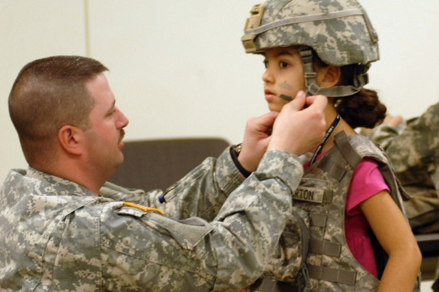 Sgt. Dwight Whorton helped Ana Lena Picciano secure her helmet at the tactical equipment station.