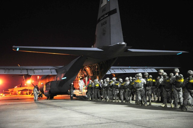 U.S. Army Paratroopers from the 82nd Airborne Division begin to load onto a C-130 used for Large Package Week during Joint Operational Access Exercise, at Pope Air Force Base, N.C., Feb. 10, 2011. Large Package Week/JOAX is an exercise that uses several Air Force C-130 and C-17 aircraft to strategically airdrop troops and cargo onto a specified location in preparation for real world contingency response. (U.S. Air Force photo/ Airman 1st Class Samuel W. Goodman)