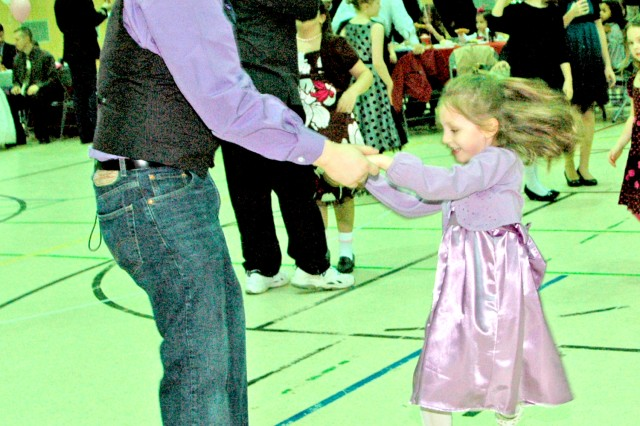 Senior Airman Timothy Ray, with the 485th Intelligence Squadron, dances with his daughter Lanah at the Daddy/Daughter Dance Feb. 5, at the Wiesbaden Middle School, Germany.