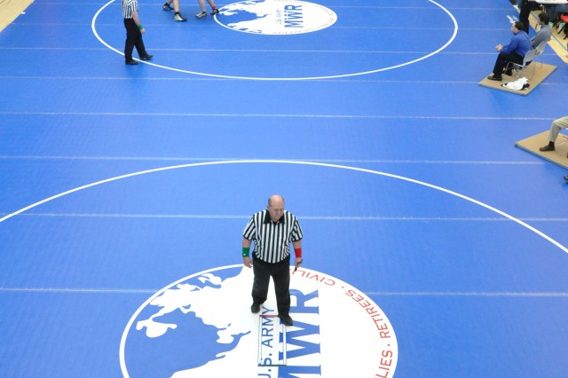 Wrestlers compete for third and fourth places at the DoDDS-Europe Wrestling Championships.