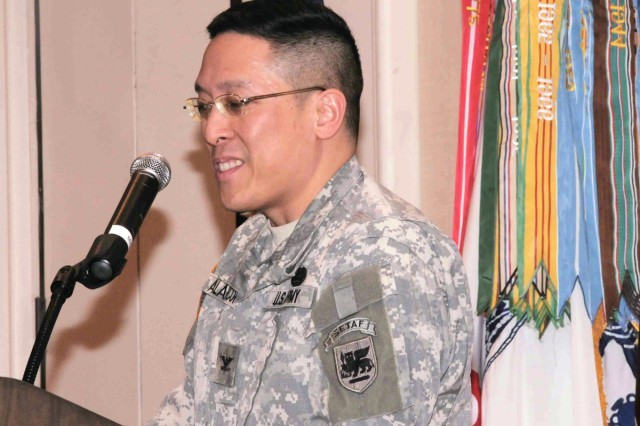 U.S. Army Africa Command Surgeon, Col. Alfonso Alarcon, addresses the Army Reserve - MEDCOM Commanders Training Workshop Feb. 11 in Tampa, Fla.