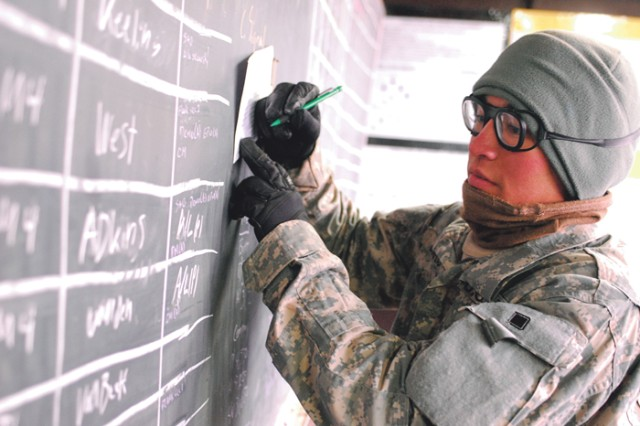 1st Lt. David Burris works on a task chart Wednesday.