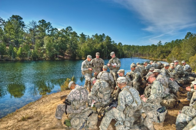 "In the third and final phase of Ranger School, Ranger students head to Camp Rudder, Fla. On Feb. 15, students received small boat movement and rope bridge training. Dubbed ""swamp phase,"" the course is located at Eglin Air Force Base near Fort Walton Beach."