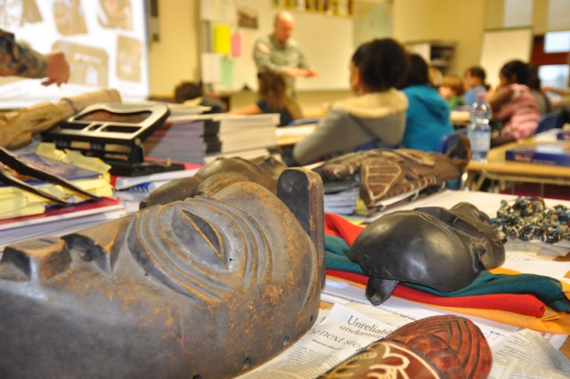 U.S. Army Africa Commander, Maj. Gen. David R. Hogg, displays African artefacts from his personal collection while visiting Vicenza Middle School in Vicenza, Italy, to teach two world geography and history classes Feb. 22, 2011.""
