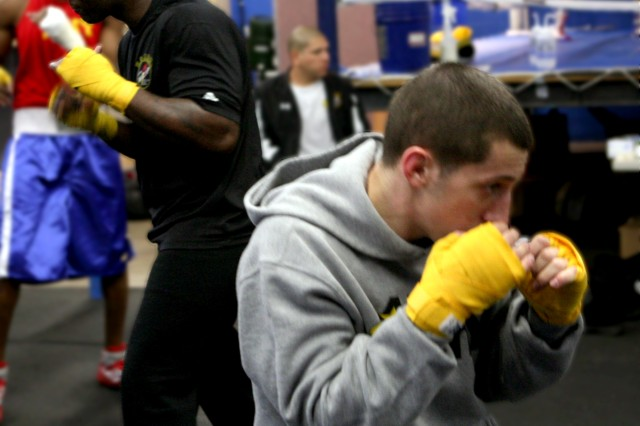 Staff Sgt. Andrew Shepherd (left), Fort Carson, Co. and Capt. Michael Benedosso, WCAP, prepare for the All-Armed Forces competition at Barnes Field House. This week's events at Lackland Air Force Base, San Antonio, Texas, will help individual boxers qualify for the 2012 Olympic trials.