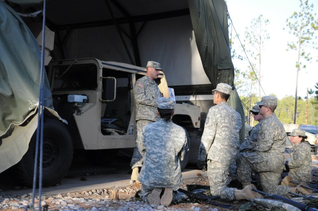 Staff Sgt. Jon Guzman, an instructor with the 187th, briefs Advanced Individual Training Soldiers on their first mission during a field training exercise.