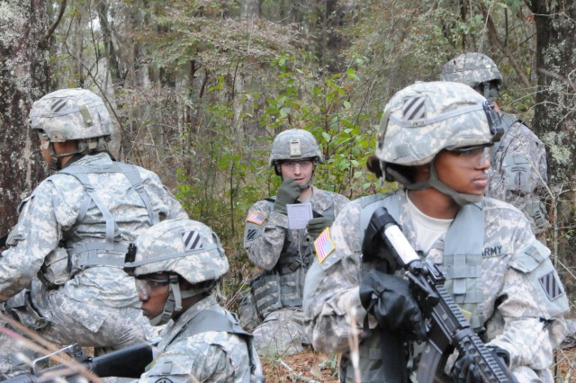 FORT STEWART, Ga. - Soldiers attending the WLC at the NCO Academy perform security as their squad leader reports a discovered UXO to Higher HQ by calling in a 9-Line UXO report, Dec. 17, during a patrol exercise.