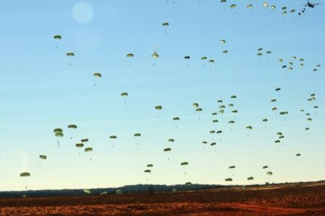 A C-130 Hercules drops paratroopers from the 82nd Airborne Division over Sicily Drop Zone at Fort Bragg, N.C., Feb. 9, during Joint Operational Access Exercise 11-01.