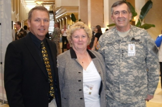 "Kevin Herman (left) and Laurene ""Susie"" Krueger meet with Army Vice Chief of Staff Gen. Peter W. Chiarelli at the Department of the Army Army Family Action Plan Conference in Virginia."