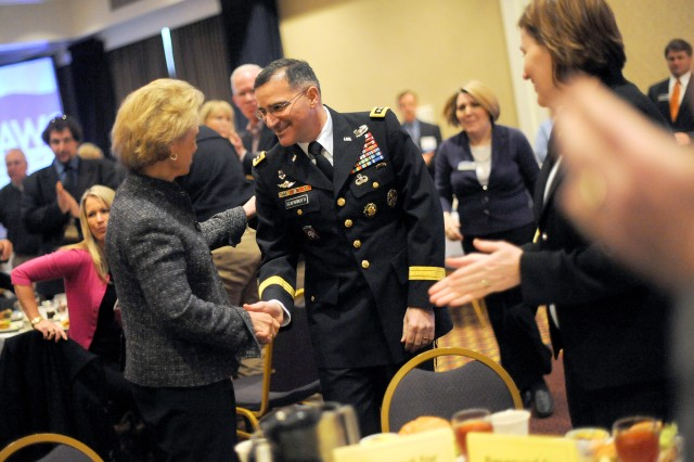 Washington Governor Christine Gregoire greets Lt. Gen. Mike Scaparrotti I Corps commanding general, during the Association of Washington Cities' City Legislative Action Conference luncheon Feb. 16, 2011 in Olympia, Wash.