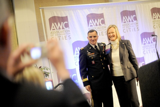 Lt. Gen. Mike Scaparrotti, I Corps commanding general, and City of Puyallup Mayor Kathy Turner pose for a photograph during the Association of Washington Cities' City Legislative Action Conference luncheon Feb. 16, 2011 in Olympia, Wash.