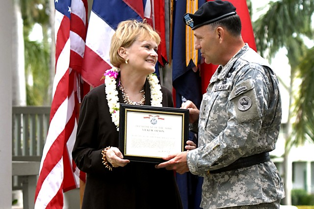 Vicki Olson receives the Secretary of the Army Public Service Award from Lt. Gen Benjamin R. Mixon, U.S. Army Pacific commander, Feb. 23 at Fort Shafter, Hawaii. Olson received the award for extraordinary contributions to the 25th Infantry Division, U.S. Army Garrison Hawaii and U.S. Army from July 2005 through December 2010.  Her contributions included developing a school program for on-post students and expanding the local USO to include support to deploying Soldiers.