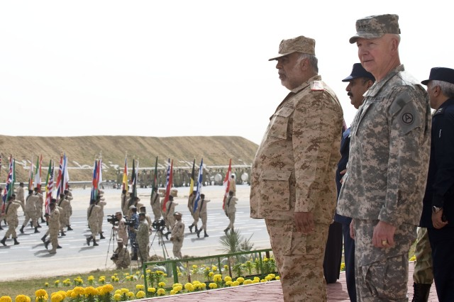 Lt. Gen. Sheikh Ahmad Al-Khaled Al-Hamad Al-Sabah, chief of staff of the Kuwait Army and Lt. Gen. William G. Webster, commanding general, Third Army/U.S. Army Central observe the rehearsal of the Kuwait 50/20 Celebration parade Feb. 22. U.S. Central Comand will support with military vehicles, aircraft, an honor guard and troops who will march in the parade.  Participation in the parade highlights the U.S. military's long-term commitment to Kuwait and the region.  (Photo by Staff Sgt. Nicholas Salcido, Third Army Public Affairs)