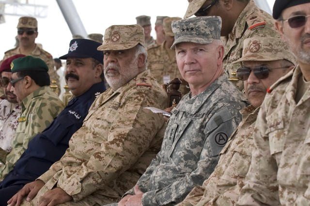 Lt. Gen. Sheikh Ahmad Al-Khaled Al-Hamad Al-Sabah, chief of staff of the Kuwait Army, Lt. Gen. William G. Webster, commanding general, Third Army/U.S. Army Central along with other guests of the Kuwait military, look on from a viewing stand during a rehearsal of the Kuwait 50/20 Celebration parade Feb. 22. The U.S. was asked to participate in the parade celebrating the 50 years of Kuwait's independence and 20 years of their liberation.  The strong relationship between the two countries continues to promote security and stability across the region. (Photo by Staff Sgt. Nicholas Salcido, Third Army Public Affairs)