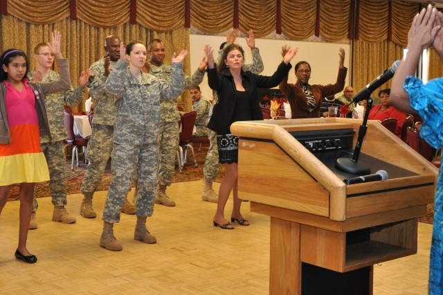 Members of the Fort Carson community learn an African song and dance from the Black Hands Drum Ensemble during the Fort Carson Black History Month Observance Feb. 15 at the Elkhorn Conference Center.