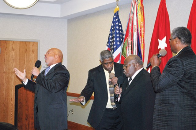 "Wayne Jones Sr., far left, leads ""The Chosen Four"" gospel group from Junction City during ""Buffalo Soldier"" at the Black History Month Observance Feb. 16 at Riley's Conference Center. The group includes members, from left to right, Jones, Leander Sharp Sr., Walter Givens and Vondell David,"