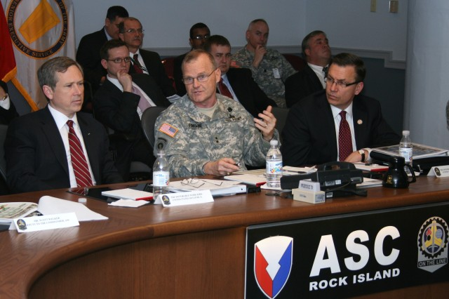 Maj. Gen. Yves J. Fontaine, commanding general of Army Sustainment Command, briefs U.S. Sen. Mark Kirk (left) and U.S. Rep. Bobby Schilling (right) during a visit to Rock Island Arsenal on Feb. 25. Kirk holds the Illinois Senate seat previously held by President Barack Obama and Schilling represents Illinois' 17th District. The visit was an opportunity for them to learn about the missions of Army Sustainment Command, the Arsenal Garrison, Joint Munitions Command, Army Contracting Command-Rock Island and the economic impact of the installation on the Quad-Cities area.