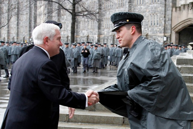Military Academy Cadet First Capt. Marc Beaudion greets Defense Secretary Robert M. Gates on the steps of Washington Hall before the lunch formation at the U.S. Military Academy, West Point, N.Y., Feb. 25, 2011. After lunch, Gates spoke to the cadets about ways they can change Army culture.