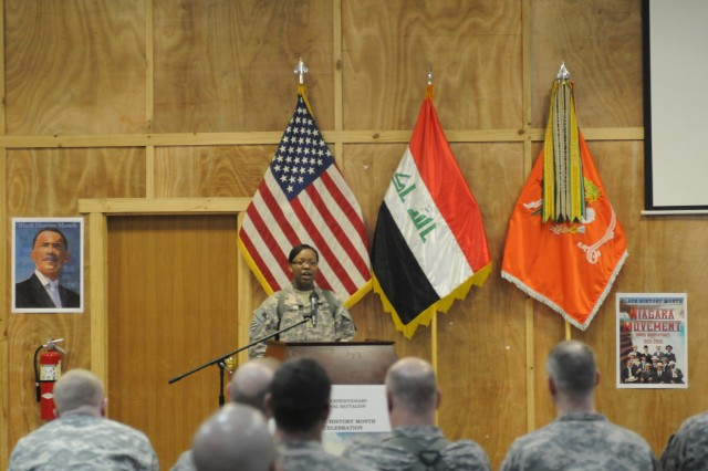 Maj. Ericka M. Brooks, the executive officer of the 40th ESB, speaks to the Soldiers about the significance of Black History Month during the celebration held in the multipurpose room on Camp Victory, Feb. 16. Brooks was the keynote speaker during the celebration.