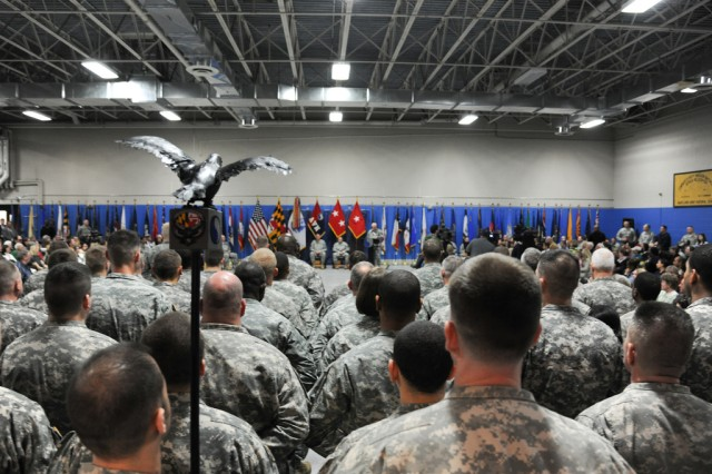 Soldiers stand at attention during their unit's deployment ceremony at Aberdeen Proving Ground's Maj. Gen. Warren D. Hodges Armory Feb. 26.