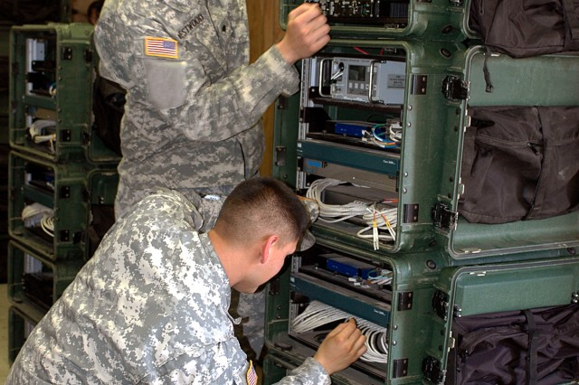 FORT HOOD, Texas-Spc. Daniel Westwood (standing), from Spanish Fort, Ala., and Spc. Nicholas Borrego, of Lamesa, Texas, both multi-channel transmissions system operator/maintainers for 41st Fires Bde., operate the command post node during the hands-on portion of the High Capacity Line-of-Site certification training on Fort Hood, Texas, Feb. 24. Rail Gunner Soldiers learned how to operate, connect, maintain, and repair the HCLOS equipment.