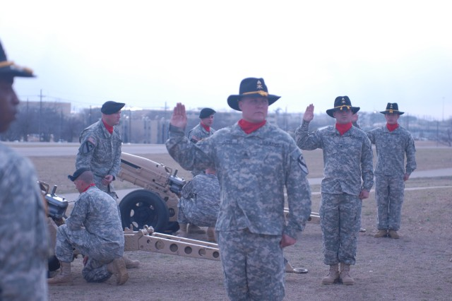 FORT HOOD, Texas -Section chiefs assigned to the Battery B, 1st Battalion, 82nd Field Artillery Regiment, 1st Brigade Combat Team, 1st Cavalry Division, stand ready to fire an Artillery Salute during the Farewell Ceremony for outgoing Brig. Gen. John Rossi, here, Feb. 22.  The 75 mm Pack Howitzers, which reside on the III Corps Parade Field, belong to the Dragon Battalion.