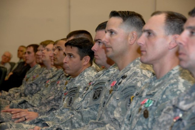 Soldiers from the 3rd Special Forces Group (Airborne) listen to remarks during a Valor Award Ceremony at the John F. Kennedy Auditorium, Fort Bragg, N.C.  Thirty-seven Soldiers from the 3rd Special Forces Group (Airborne) received awards for their valor on the battlefield while serving in Afghanistan.