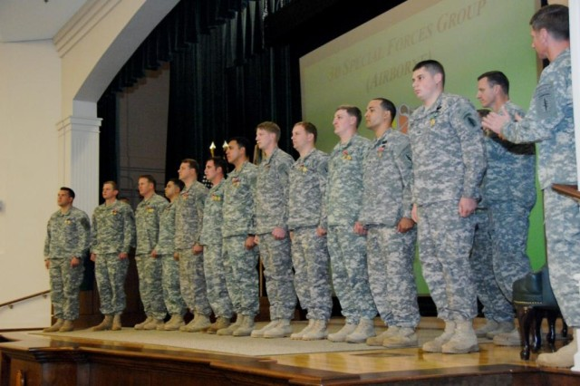 Soldiers from Operational Detachment Alpha 3336, 3rd Battalion, 3rd Special Forces Group (Airborne) receive awards for their valor on the battlefield while serving in Afghanistan, during the Group's Valor Award Ceremony at the John F. Kennedy Auditorium, Fort Bragg, N.C.