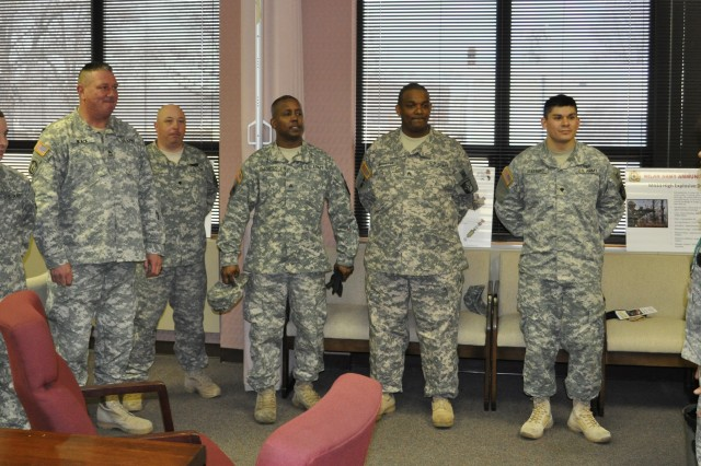 Lt. Col. Maria Eoff, commander for the Milan Army Ammunition Plant, expresses her gratitude to (right to left) Spc. Adam Guerrero, Staff Sgt. Alex Thibodeaux, Sgt. Joe Daniels, Spc. Phillip Just, Sgt. 1st Class Ray Black, and Pvt. Barrett LaCount for their outstanding work during the Network Connection breakfast at MLAAP in Milan, Tenn.