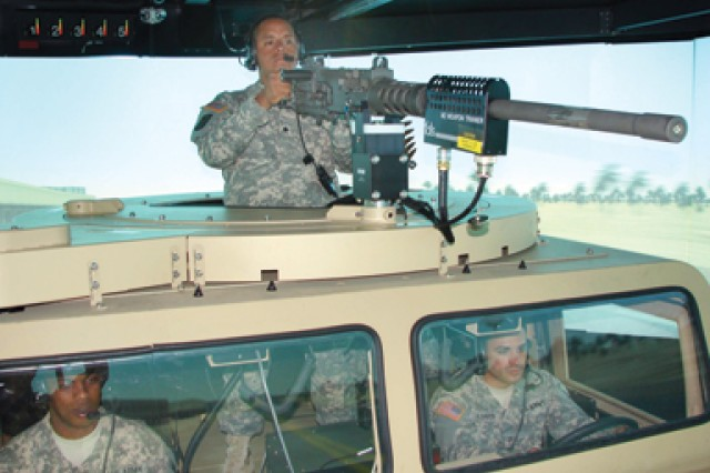 Soldiers in 25th Transportation Company, 25th Infantry Division, man a turret during a virtual convoy on the Reconfigurable Vehicle Tactical Trainer.