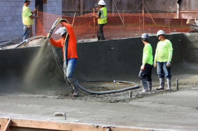 Crews work on an aquatics facility with a swimming pool and spray park that is among the highlights of the Wilikina Community Center in the Wili Wili neighborhood at Wheeler Army Airfield, in 2010.