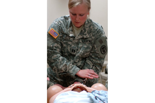 Capt. Katherine Dengler, a resident in the OB/GYN department at the Brooke Army Medical Center in San Antonio, traveled to Fort Hood, Texas, to instruct the 41st Fires Brigade medics how to deliver babies and emergencies that can arise in pregnancies. Dengler brought a training aid, the Noel Doll to help assist her in her training.