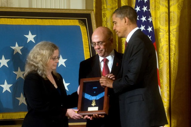 President Barack Obama presents the Medal of Honor to Phil and Maureen Miller, the parents of Staff Sgt. Robert J. Miller, during a ceremony at the White House, Oct. 6, 2010. Miller, a Green Beret, was killed in Afghanistan in 2008 during an ambush where he was credited with saving the lives of seven American and 15 Afghan soldiers.
