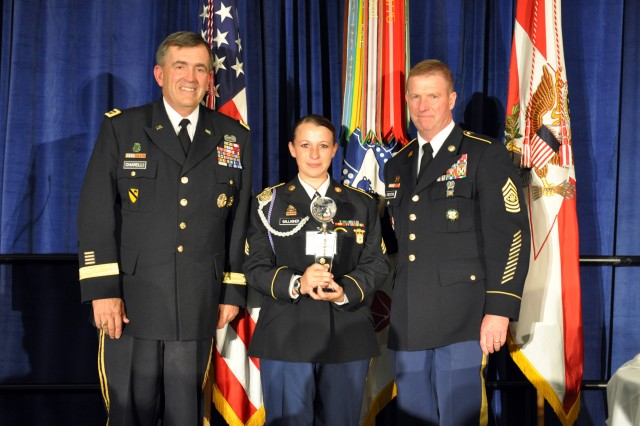 Sgt. Sherri Jo Gallagher, U.S. Army Marksmanship Unit, stands with Gen. Peter Chiarelli, Army vice chief of staff, and Sgt. Maj. of the Army Kenneth O. Preston after being named the 2010 Soldier of the Year. Gallagher and 23 other Soldiers and noncommissioned officers competed in the 2010 Best Warrior Competition at Ft. Lee, Va., Oct. 18-22, 2010.