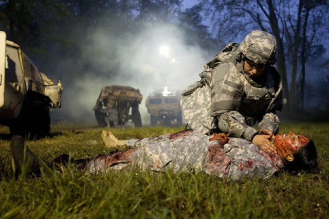 Sgt. Sherri Jo Gallagher assesses a mock casualty at the warrior skills lane during the Best Warrior Competition Oct. 21, 2010. Gallagher was named the Soldier of the Year at the Association of the United States Army award luncheon in Washington.