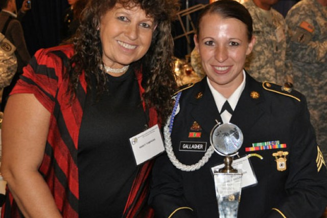 Sgt. Sherri Jo Gallagher and her mother, Nancy Tompkins, celebrate after Gallagher was named Soldier of the Year at the Association of the United States Army annual meeting. Gallagher and her mother are the only women to ever win the National High-Power Rifle Championship.