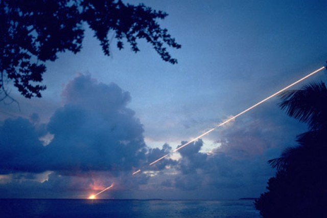 A test missile streaks across the night sky at Kwajalein.