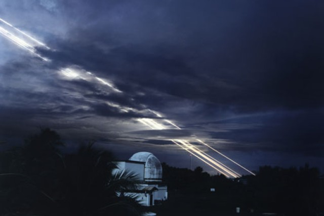 Test missiles streak across the night sky at Kwajalein.