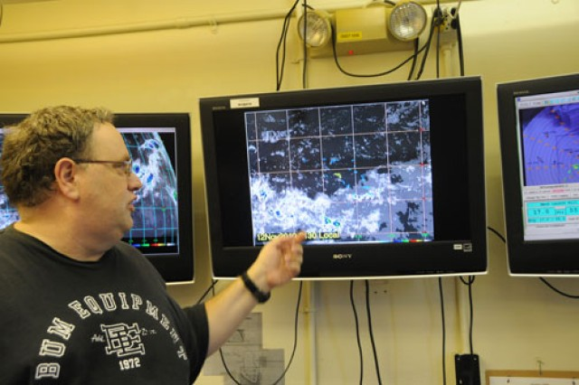 Mark Bradford, lead meteorologist, is responsible for ensuring the weather over the island will cooperate with the mission.