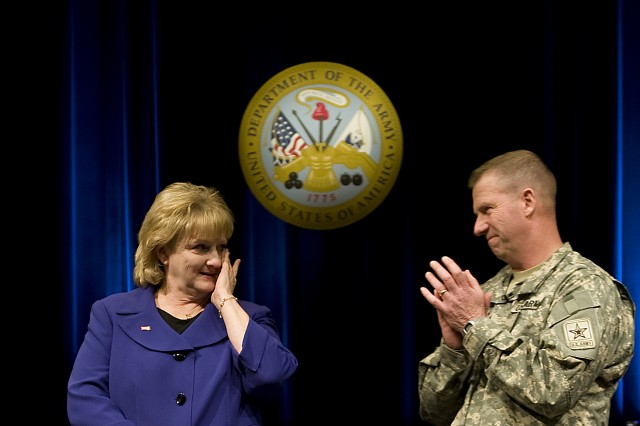 Sgt. Maj. of the Army Kenneth O. Preston leads an applause for his wife, Karen, during an event held in honor of the Prestons service at the Pentagon in Washington DC on Feb. 25, 2011.  Preston has served as the Army's top enlisted adviser for seven years and while retire on Mar. 1, 2011