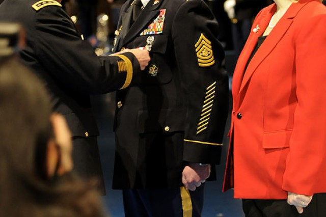 Army Chief of Staff Gen. George W. Casey Jr. pins the Distinguished Service Medal on Sergeant Major of the Army Kenneth O. Preston during Preston's retirement ceremony at Joint Base Myer-Henderson Hall's Conmy Hall, March 1, 2011.