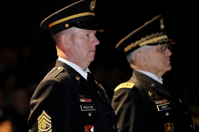 Sgt. Maj. of the Army Kenneth O. Preston stands abreast with Army Chief of Staff Gen. George W. Casey Jr. during Preston's retirement ceremony at Joint Base Myer-Henderson Hall's Conmy Hall, March 1, 2011.
