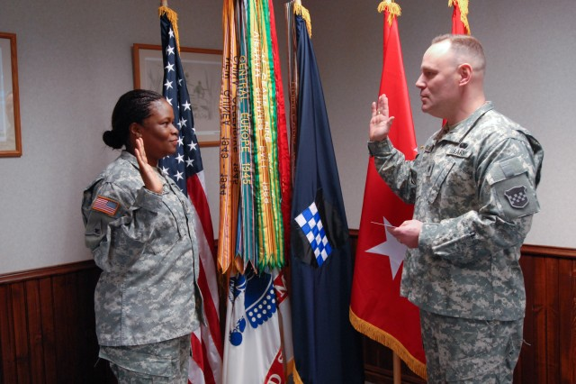 Lt. Col. Kurt O'Rourke (right), Plans, Analysis and Integration Officer, 99th Regional Support Command, reads the oath of reenlistment and swears in Staff Sgt. LaTonya Terry-Matthews (left) a native of Arlington, Va., on Feb. 24 at the Maj. John P. Pryor Army Reserve Center on Joint Base McGuire-Dix-Lakehurst. Terry-Matthews re-enlisted for six years and is currently assigned as a Budget NCO for the 99th Regional Support Command. (Photo by Sgt. 1st Class Alyn-Michael Macleod)