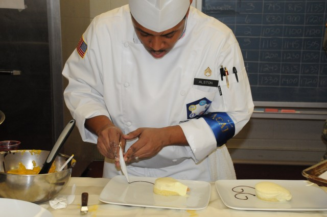 Staff Sgt. Motavia Alston, Pentagon team, puts the final touches on his dessert plate during the Armed Forces Chef of the Year event that kicked off the 36th Annual Culinary Arts Competition at Fort Lee, Va.
