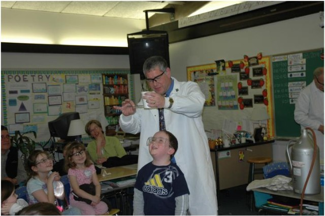 """During """"The Magic of Science"""" break-out session, Edgewood Chemical Biological Center scientist Ken Collins conducts a demonstration using Water Willie, a water-thickening agent used in the ECBC lab, for 5-year-old Liam Rosesener and audience"""