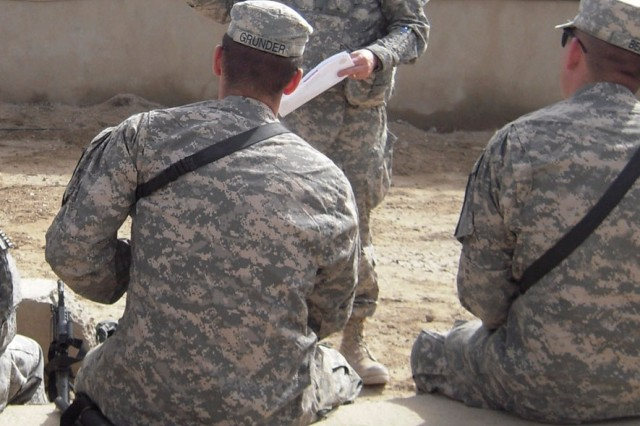 BAGHDAD, Iraq -Troopers with 6th Squadron, 9th Cavalry Regiment, attached to 2nd Advise and Assist Brigade, 1st Infantry Division, United States Division - Center, receive instruction on non-lethal weapons and their purpose in our advise and assist mission Feb. 23.